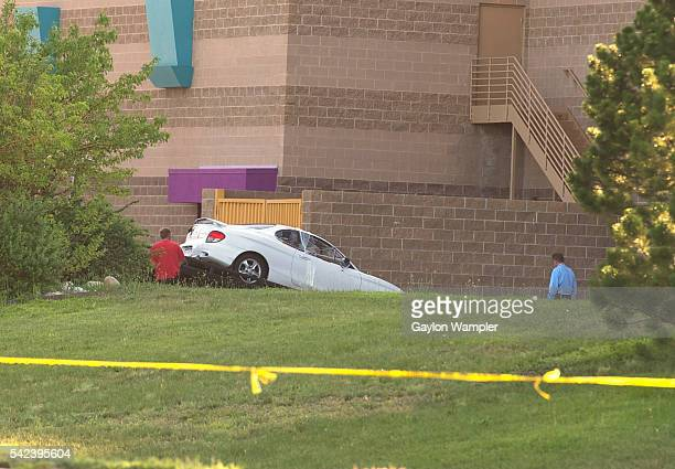 Investigaors remove the car belonging to Suspect shooter James Holmes at the rear of the Century 16 movie theater in Aurora CO Friday afternoon 12...