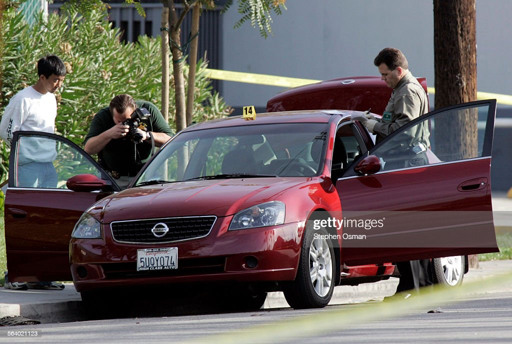 Investigator examine the suspects Nissan Altima near the scene Three employees at a Signal Hill business called the Kenyon Press were shot by a...