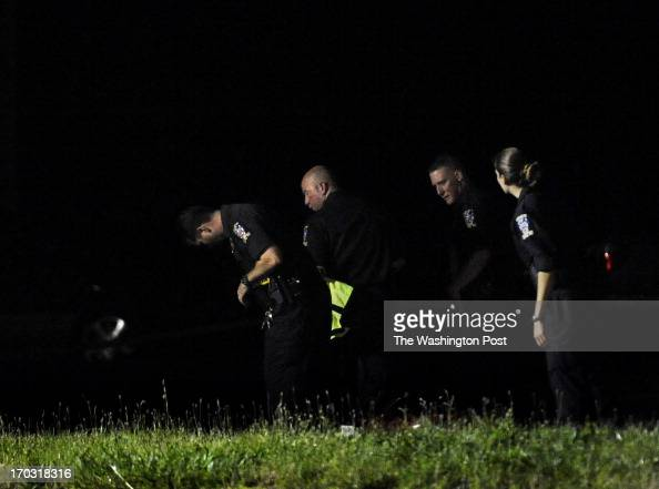 Investigator search for clues on the median on Georgia Ave following a fatal 3vehicle crash that killed a total of 3 people The Montgomery County...