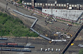 Investigators and first responders work near the wreckage of Amtrak Northeast Regional Train 188 from Washington to New York that derailed late last...