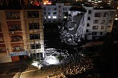 Investigators check the site of a series of blasts at a damaged building in Liucheng county in Liuzhou in south China's Guangxi province on September...