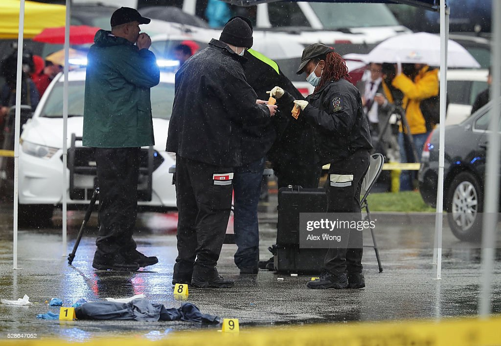 Investigators collect evidence that was left behind at a shooting crime scene at Westfield Montgomery Mall May 6, 2016 in Bethesda, Maryland. At least two people were killed and two injured in two separate shootings in Montgomery County, Maryland.