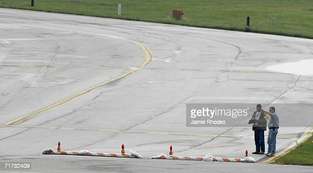 Investigators document the runway that Comair Flight 5191 attempted to depart from August 28 2006 in Lexington Kentucky Fortyseven passengers and two...