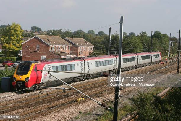Investigators examine a train which collided with a car late Monday evening on the East Coast Main Line in the village of Copmanthorpe