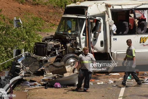 Investigators examine the accident scene after a charter bus which overturned on I95 southbound was righted on Monday May 15 2017 in Havre de Grace...