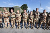 Investigators from the French Air Transport Gendarmerie and the French Criminal Analysis Unit wait on July 25 2014 at VelizyVillacoublay's military...
