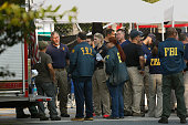 FBI investigators gather on Monday morning June 13 2016 in front of Pulse nightclub to continue gathering materials in the investigation Fifty people...