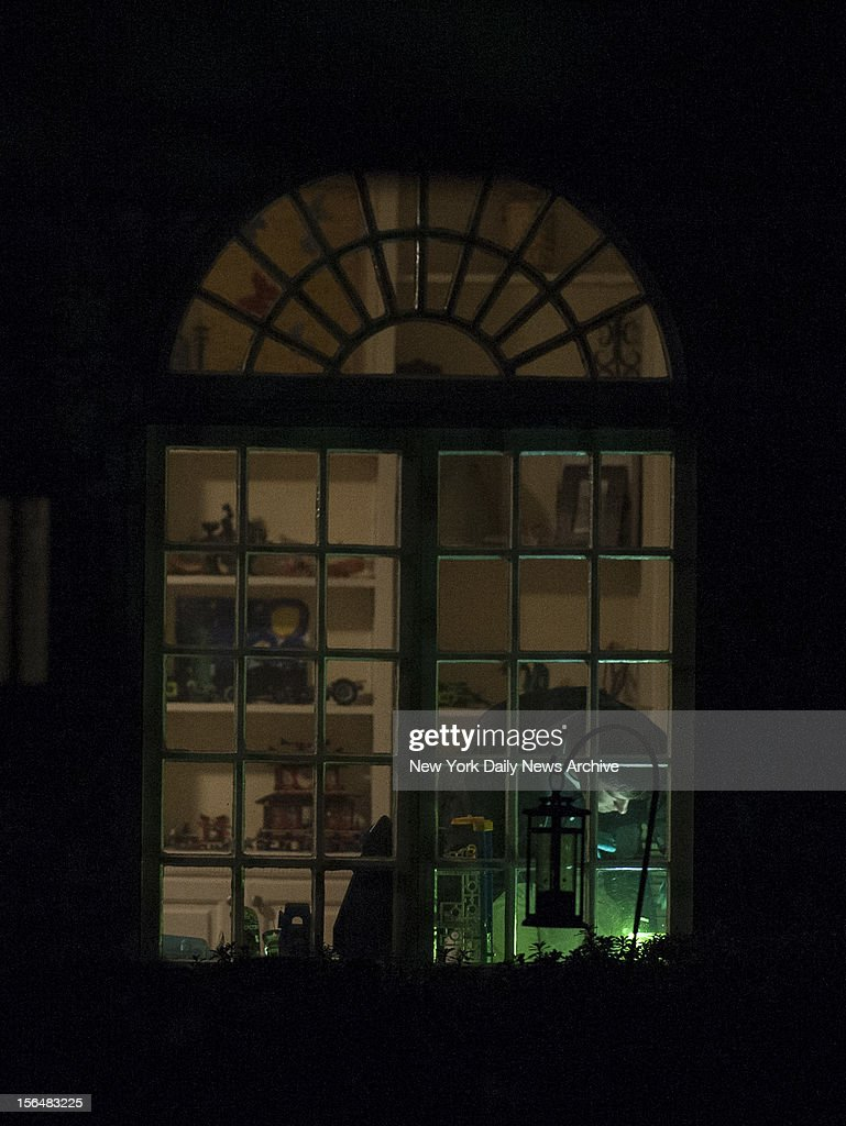 FBI investigators in the living room at the home of Paula and Scott Broadwell on November 10, 2012 in Charlotte, North Carolina. Paula is the alleged mistress of CIA Director David Petraeus.