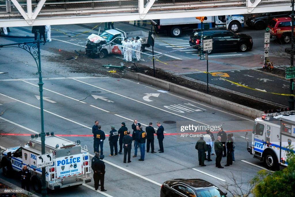 Investigators inspect a truck following a shooting incident in New York on October 31, 2017. Several people were killed and numerous others injured in New York on Tuesday when a suspect plowed a vehicle into a bike and pedestrian path in Lower Manhattan, and struck another vehicle on Halloween, police said. A suspect exited the vehicle holding up fake guns, before being shot by police and taken into custody, officers said. The motive was not immediately apparent. PHOTO / Don EMMERT