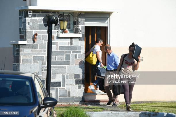 Investigators leave Albert and Monique Villemin's house after questioning them in connection with their grandson Gregory Villemin's death case in...