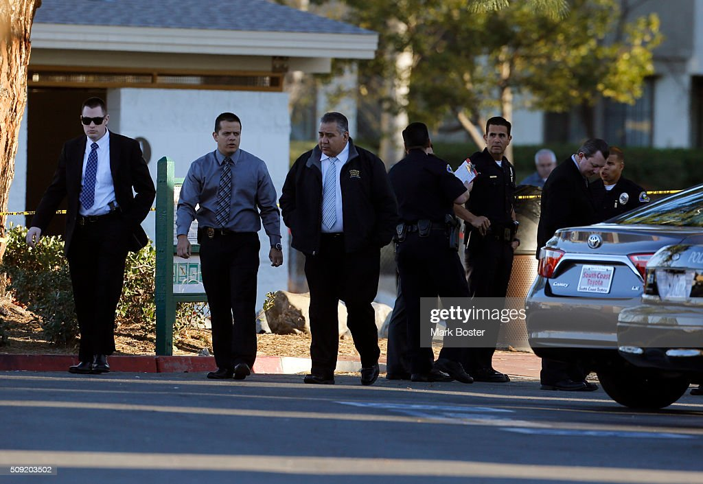 Investigators look for clues in Sage Park where an Anaheim Police Officer fatally wounded a 22-year-old man in Anaheim February 9, 2016. Officers were originally called to a nearby apartment complex where a man was knocking on doors. Police apparently confronted a man in the park and an officer involved shooting occurred