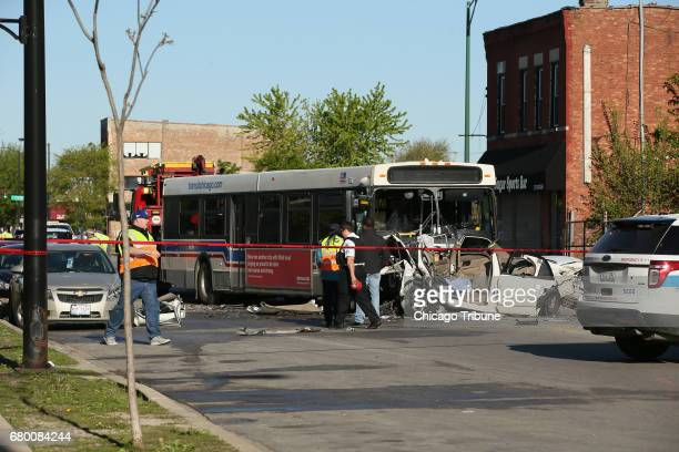 Investigators look over the scene of a fatal crash involving a CTA bus and a car on Sunday May 7 2017 in the 2600 block of West Madison Street in...