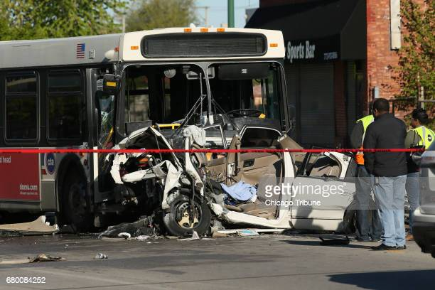 Investigators look over the scene of a fatal crash involving a CTA bus and a car which killed four people on Sunday May 7 2017 in the 2600 block of...