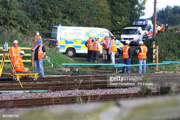 Investigators near the scene where a train which collided with a car late Monday evening on the East Coast Main Line in the village of Copmanthorpe