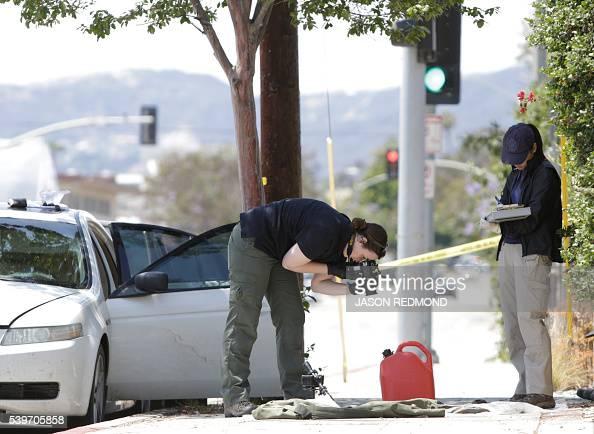 Investigators Photograph Items Near A Car In Santa Monica