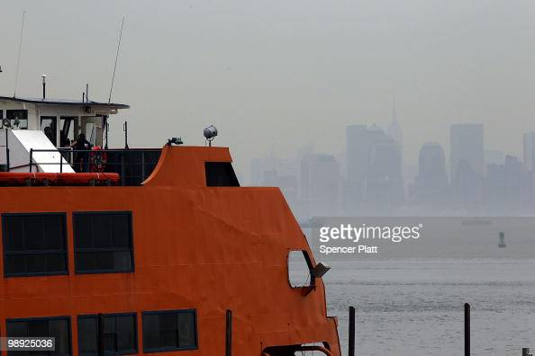 Investigators stand on the Andrew J Barbieri ferry following the crash of the Staten Island Ferry into a dock in the city's borough of Staten Island...