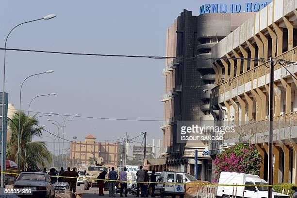 Investigators stand outside the Splendid Hotel and Cappuccino restaurant on January 17 2016 in Ouagadougou following a jihadist attack by AlQaeda...