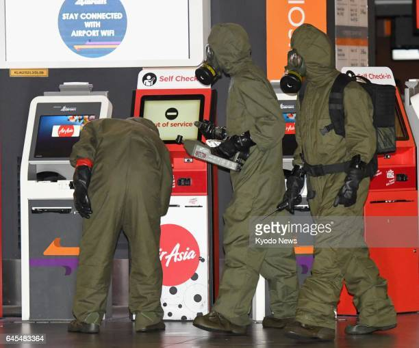 Investigators wearing protective suits continue work at Kuala Lumpur International Airport on Feb 26 looking into the murder of Kim Jong Nam the...