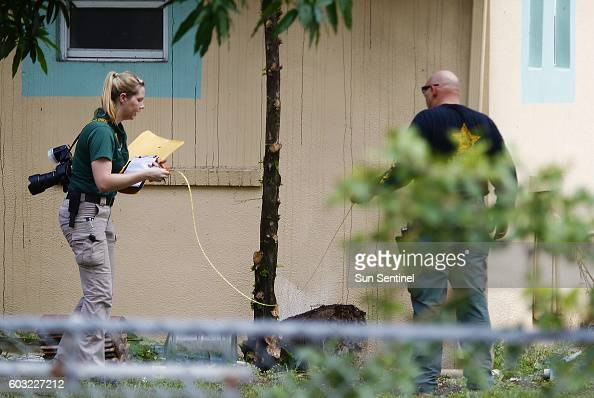 Investigators with the St Lucie County Sheriff's Office work in a yard Monday Sept 12 2016 at the Fort Pierce Islamic Center after an apparent...