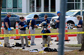 Investigators work a crime scene outside of the Curtis Culwell Center after a shooting occurred the day before May 04 2015 in Garland Texas During...