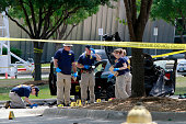 Investigators work a crime scene outside of the Curtis Culwell Center in Garland Texas on Monday May 04 2015 after a shooting occurred the day before...