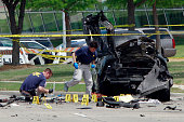 FBI investigators work a crime scene outside of the Curtis Culwell Center after a shooting occurred the day before May 04 2015 in Garland Texas...