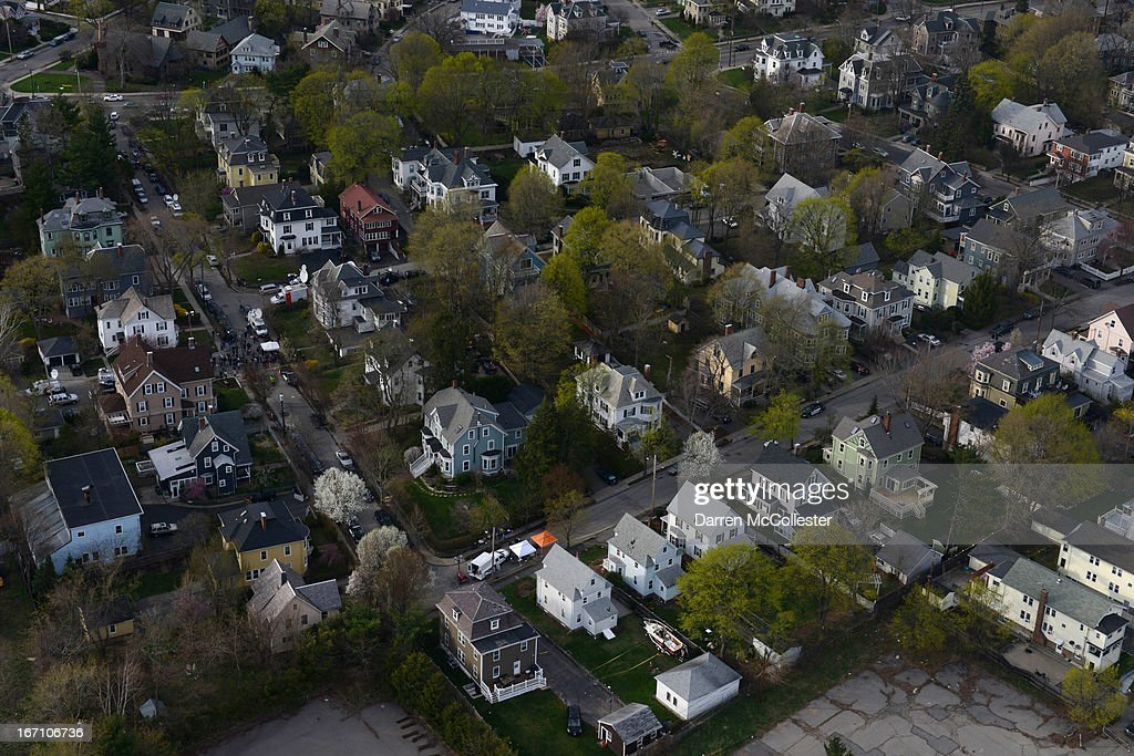 Investigators work around the boat (bottom) where Dzhokhar A. Tsarnaev was found hiding after a massive manhunt, in the backyard of a Franklin Street home, in an aerial view April 20, 2013 in Watertown, Massachusetts. A manhunt for Dzhokhar A. Tsarnaev, 19, a suspect in the Boston Marathon bombing ended after he was apprehended on a boat parked on a residential property in Watertown, Massachusetts. His brother Tamerlan Tsarnaev, 26, the other suspect, was shot and killed after a car chase and shootout with police. The bombing, on April 15 at the finish line of the marathon, killed three people and wounded at least 170.