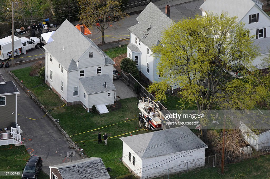 Investigators work around the boat where Dzhokhar A. Tsarnaev was found hiding after a massive manhunt, in the backyard of a Franklin Street home, in an aerial view April 20, 2013 in Watertown, Massachusetts. A manhunt for Dzhokhar A. Tsarnaev, 19, a suspect in the Boston Marathon bombing ended after he was apprehended on a boat parked on a residential property in Watertown, Massachusetts. His brother Tamerlan Tsarnaev, 26, the other suspect, was shot and killed after a car chase and shootout with police. The bombing, on April 15 at the finish line of the marathon, killed three people and wounded at least 170.