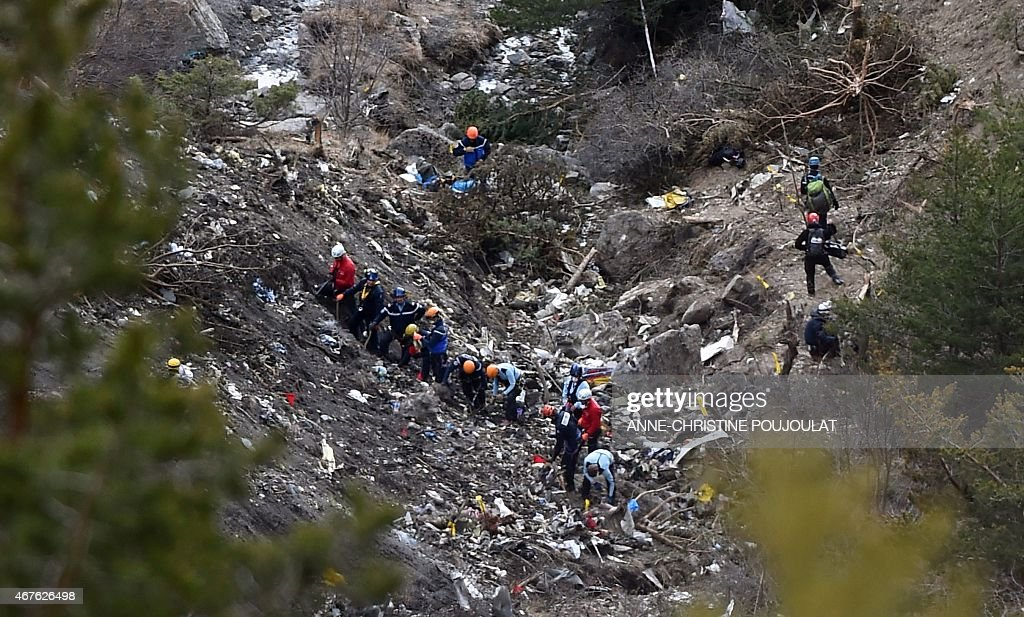 Investigators work on scattered debris on March 26 2015 on the crash site of the Germanwings Airbus A320 that crashed in the French Alps above the...