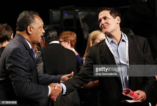 Investor and Dallas Mavericks shakes hands with Jesse Jackson before the start of the third US presidential debate at the Thomas Mack Center on...