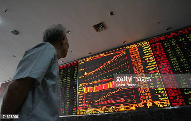 A investor views the stock index on an electronic screen at a securities company on May 30 2007 in Wuhan of Hubei Province China The Shanghai...