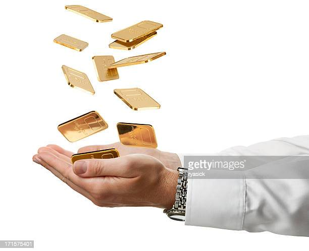 Investor with Cupped Hands Catching A Fortune of Gold Ingots