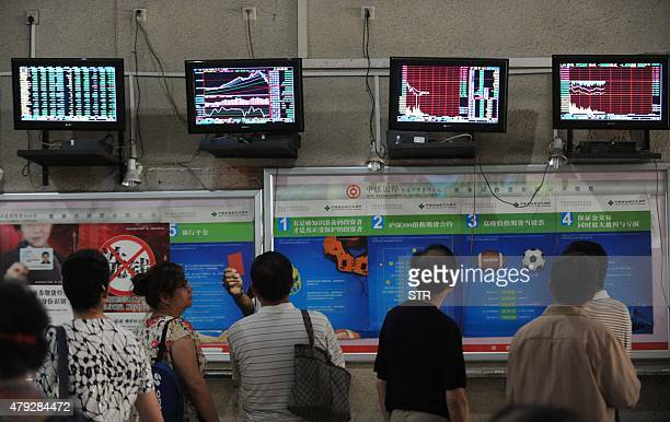 Investors monitor stock prices at a securities firm in Wuhan in central China's Hubei province on July 3 2015 Shanghai shares on July 3 extended...
