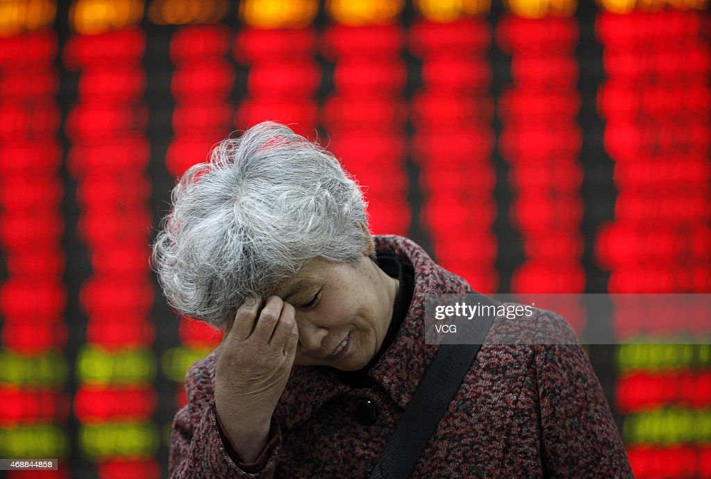 Investors observe stock market at a stock exchange corporation on April 7 2015 in Huaibei Anhui province of China The Shanghai composite index has...