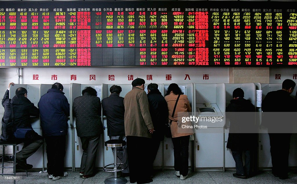 Investors view stock index on computer monitors at a securities company on March 1, 2007 in Beijing, China. China's stock market experienced its sharpest daily fall in 10 years on February 27, 2007 in spite of the premier's pledges to develop the capital market. The benchmark Shanghai Composite Index fell 83.88 points, or 2.91 per cent to 2,797.19 today.