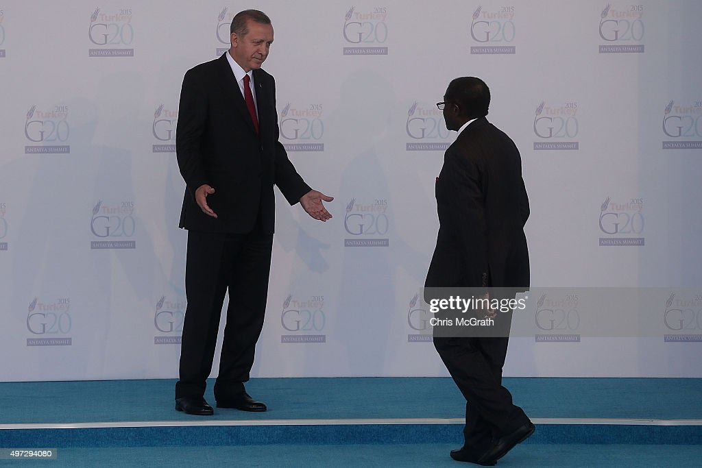 Invited guest, President of Zimbabwe Robert Mugabe(R) is greeted by Turkish President Recep Tayyip Erdogan, during the official welcome ceremony on day one of the G20 Turkey Leaders Summit on November 15, 2015 in Antalya, Turkey. World leaders will use the summit to discuss issues including, climate change, the global economy, the refugee crisis and terrorism. The two day summit takes place in the wake of the massive terrorist attack in Paris which killed more than 120 people.