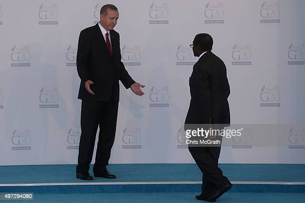 Invited guest President of Zimbabwe Robert Mugabe is greeted by Turkish President Recep Tayyip Erdogan during the official welcome ceremony on day...