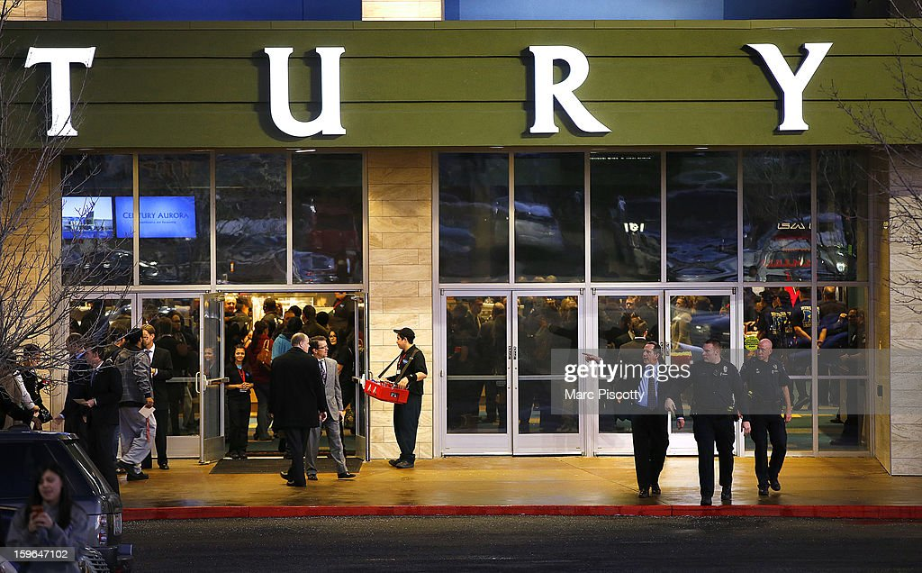 Invited guests make their way into a reopening ceremony and evening of remembrance at the Cinemark Century 16 Theaters as security patrols on January 17, 2013 in Aurora, Colorado. The theater was the site of a mass shooting on July 20, 2012 that killed 12 people and wounded dozens of others.