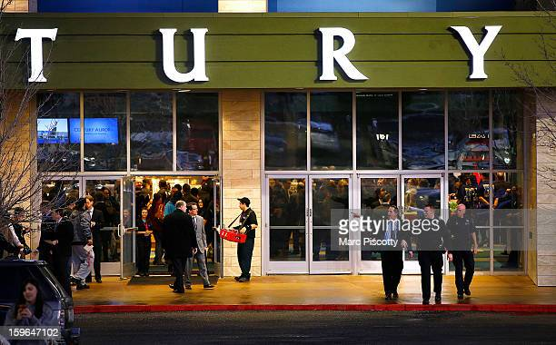 Invited guests make their way into a reopening ceremony and evening of remembrance at the Cinemark Century 16 Theaters as security patrols on January...