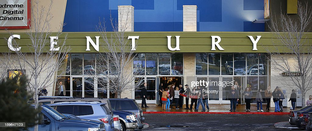 Invited guests make their way into a reopening ceremony and evening of remembrance at the Cinemark Century 16 Theaters on January 17, 2013 in Aurora, Colorado. The theater was the site of a mass shooting on July 20, 2012 that killed 12 people and wounded dozens of others.
