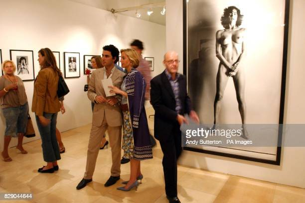 Invitees during the private view of photolondon the first annual art fair in the UK dedicated to photography at The Royal Academy in central London...