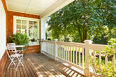 Beautiful front porch with table and chairs, on a lovely summer day