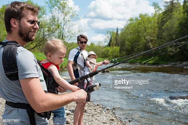Involved dads and babys fishing in a sunny day
