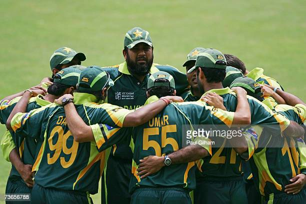 Inzamam UlHaq and his teammates gather together before fielding against Zimabawe during the ICC Cricket World Cup 2007 Group D match between Pakistan...