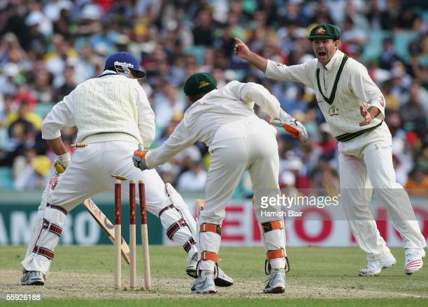 InzamamulHaq of the ICC World XI is stumped by Adam Gilchrist of Australia with Ricky Ponting of Australia looking on during day two of the Johnnie...