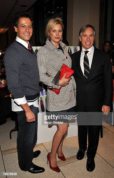 Ioan Gruffudd Alice Evans and Tommy Hilfiger pose backstage at the Tommy Hilfiger Fall 2008 fashion show during MercedesBenz Fashion Week Fall 2008...