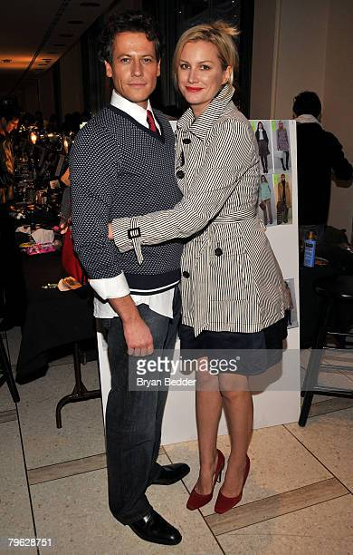 Ioan Gruffudd and Alice Evans pose backstage at the Tommy Hilfiger Fall 2008 fashion show during MercedesBenz Fashion Week Fall 2008 at Avery Fisher...