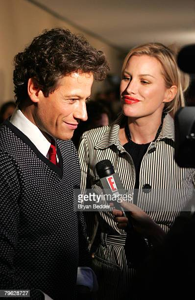 Ioan Gruffudd is interviewed as Alice Evans looks on backstage at the Tommy Hilfiger Fall 2008 fashion show during MercedesBenz Fashion Week Fall...