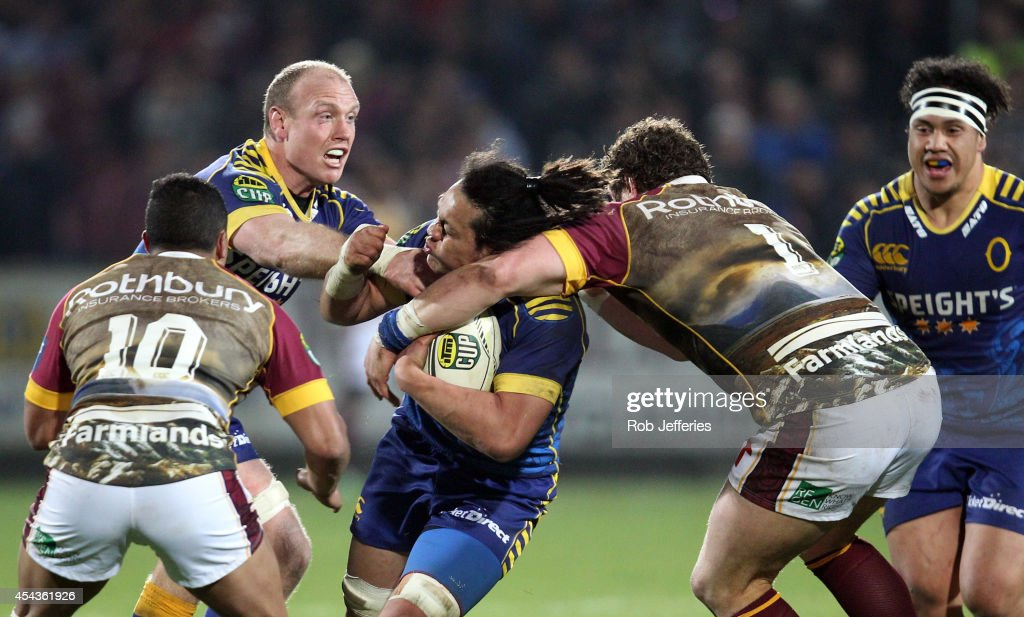 TJ Ioane of Otago is hit in a high tackle by Jamie Mackintosh of Southland during the ITM Cup match between Southland and Otago on August 30, 2014 in Invercargill, New Zealand.