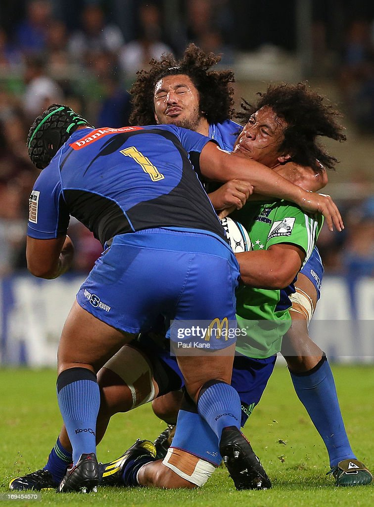 TJ Ioane of the Highlanders gets tackled by Pek Cowan and Sam Wykes of the Force during the round 15 Super Rugby match between the Western Force and the Highlanders at nib Stadium on May 25, 2013 in Perth, Australia.